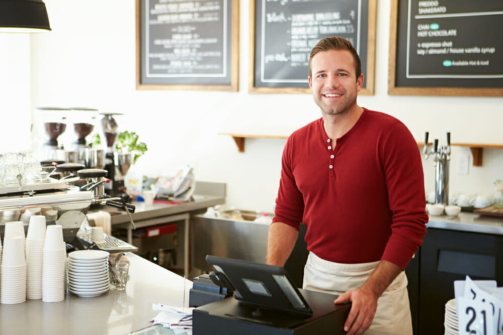 Man at counter at commercial business